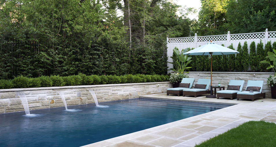 Photo slideshow of Artistic Gardens' design projects: swimming pool with fountain spouts, flagstone terrace, privacy screen