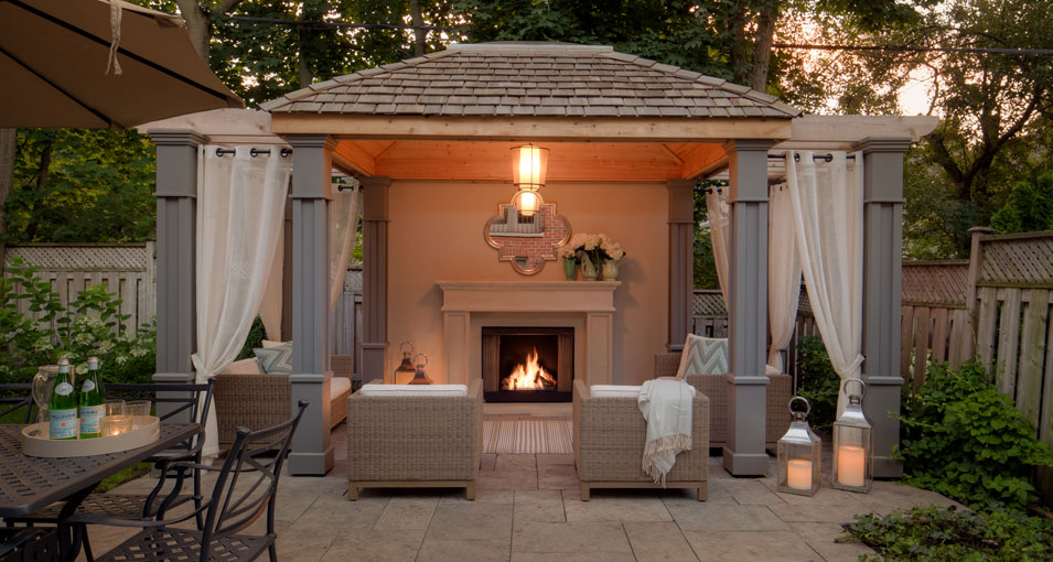 Photo slideshow of Artistic Gardens' design projects: gazebo with fireplace